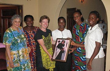 Kathy Gibbons Director of Marketing, African Province, Society of the Holy Child Jesus, presenting the Holy Child Sisters in Oghara, Delta State, Nigeria, a framed reproduction of Jesus of the People for their school, Our Lady of Nigeria.